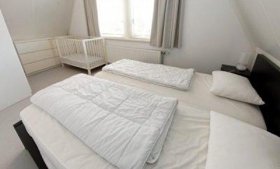 De comfortabele tweepersoonskamer