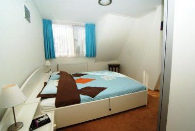 De heerlijke frisse slaapkamer